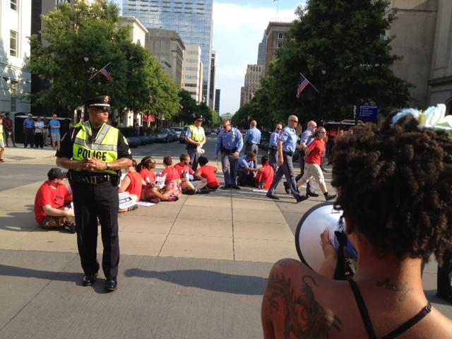 Police arrested 14 educators who refused to leave the intersection.