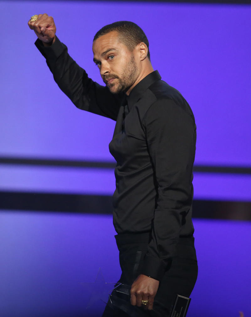 Photo of Jesse Williams accepting an award at the BET Awards.