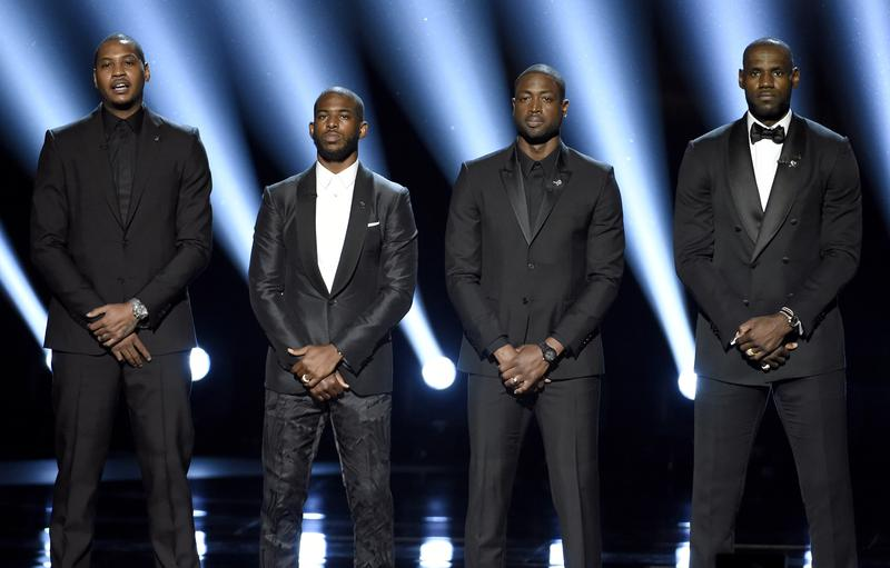 Photo of Carmelo Anthony, Chris Paul, Dwyane Wade and LeBron James speaking at the ESPY Awards.