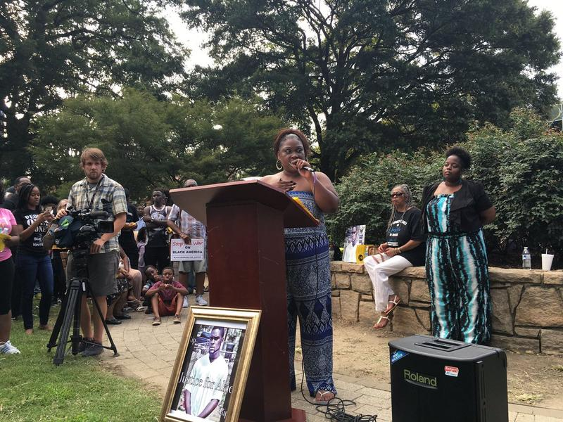 Rolanda Byrd, whose 24-year-old son Akiel Denkins was killed by a white police officer in Southeast Raleigh, spoke at a vigil on Friday.