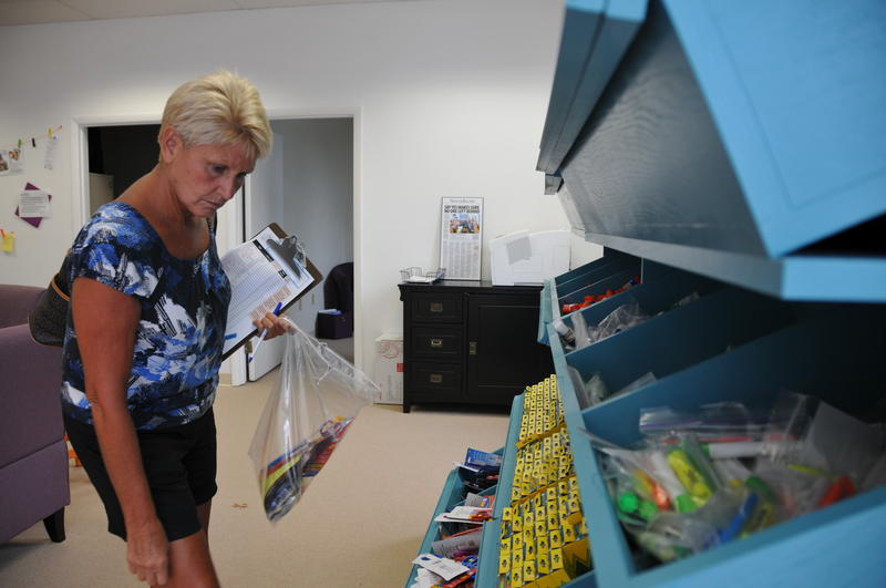 Guilford County fourth grade math teacher Diana Watson scopes out the shelves of donated markers and highlighters at the Guiford Teacher Supply Warehouse.