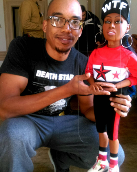 Photo of Tarish Pipkins with a puppet