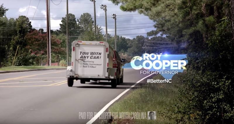 Attorney General Roy Cooper's campaign ads attack Governor Pat McCrory's record on education funding.