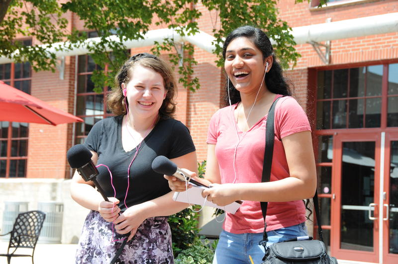 2016 Summer Reporter Institute interns Claire Goray, left, and Gayathri Raghavendra, right, on assignment.