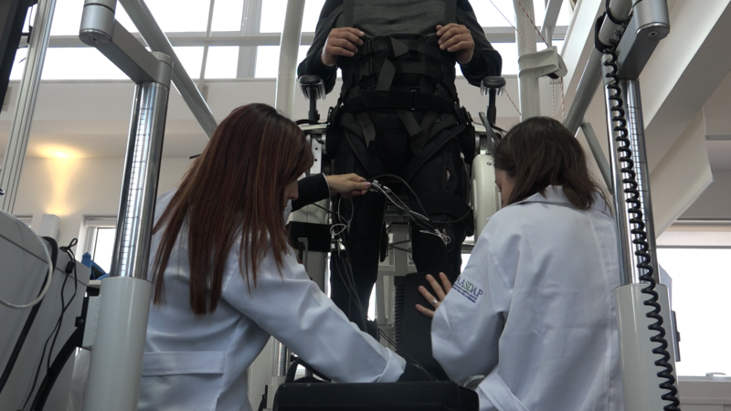 Photo of a patient being prepped in the Lokomat