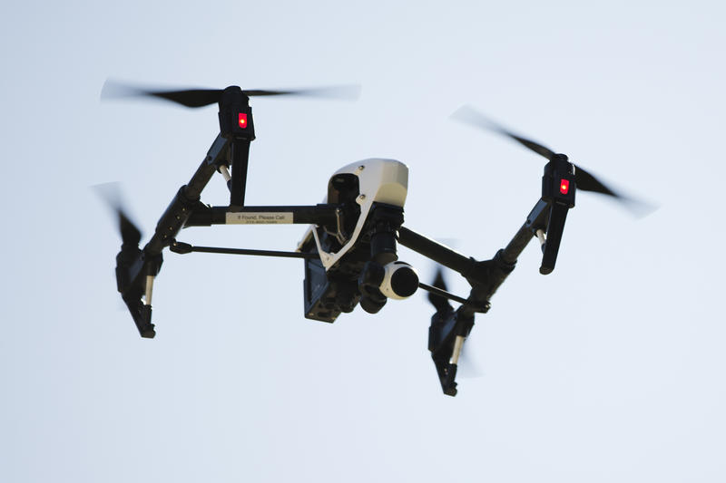 Am image of a drone capturing videos and still images of an apartment building in Philadelphia.