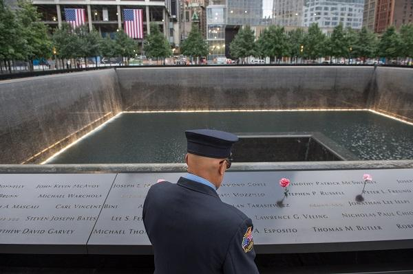 Retired New York City firefighter Joseph McCormick visits the South Pool prior to a ceremony at the World Trade Center site in New York on Friday, Sept. 11, 2015.