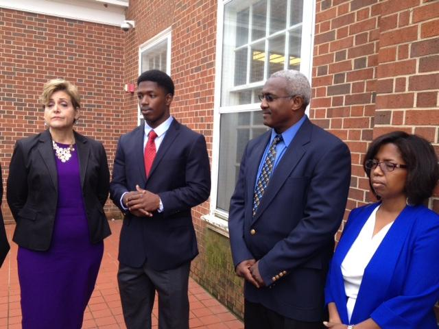 UNC linebacker Allen Artis (second from left) with his attorney Kerry Sutton (far left) and parents Johnny and Stephanie Artis.