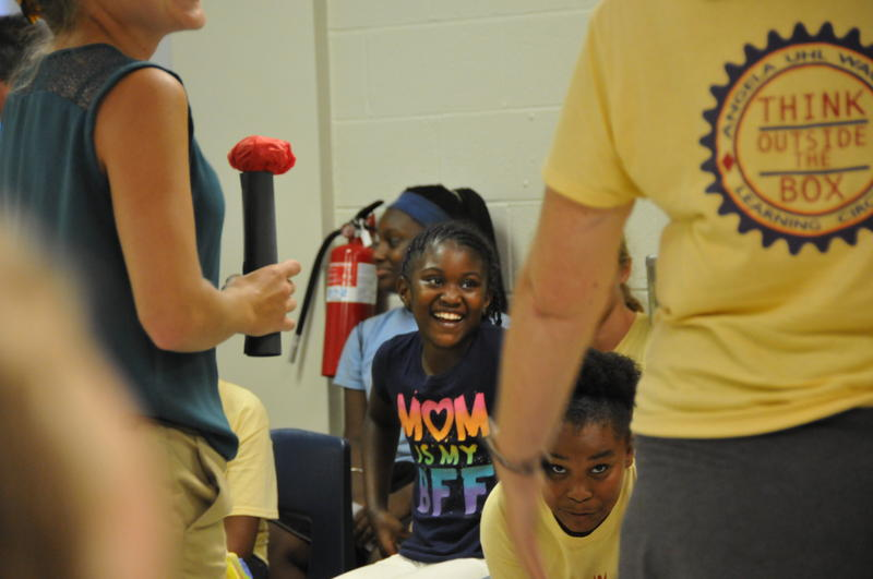 GLOW students Trinity Moore and Deniya Evans reacted to a lip-syncing performance by their teachers.