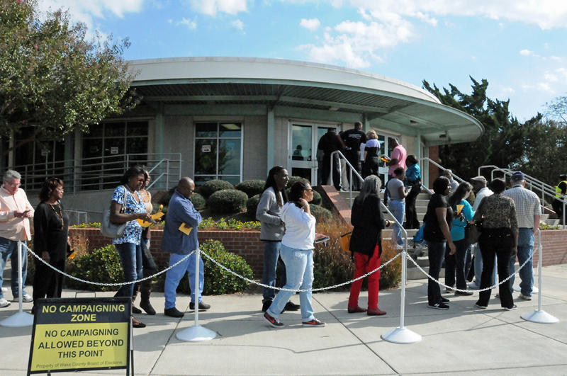 Voters in North Carolina line up outside the Chavis Community Center in Raleigh to vote early on Friday, October 21, 2016.