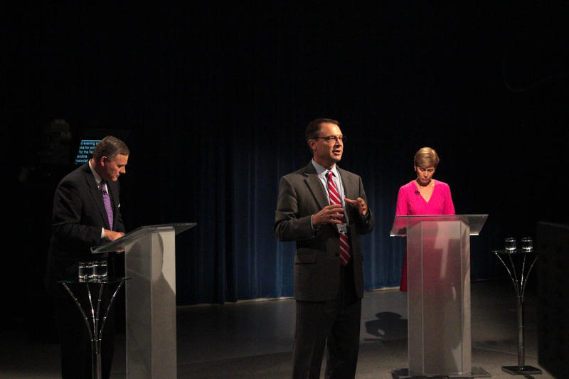 Steve Hammel (middle), vice president & general manager at WRAL-TV, introduces Sen. Richard Burr, R-NC, (left) and former Democratic State Representative Deborah Ross (right) at the first U.S. Senate debate held in Durham on October 13, 2016.