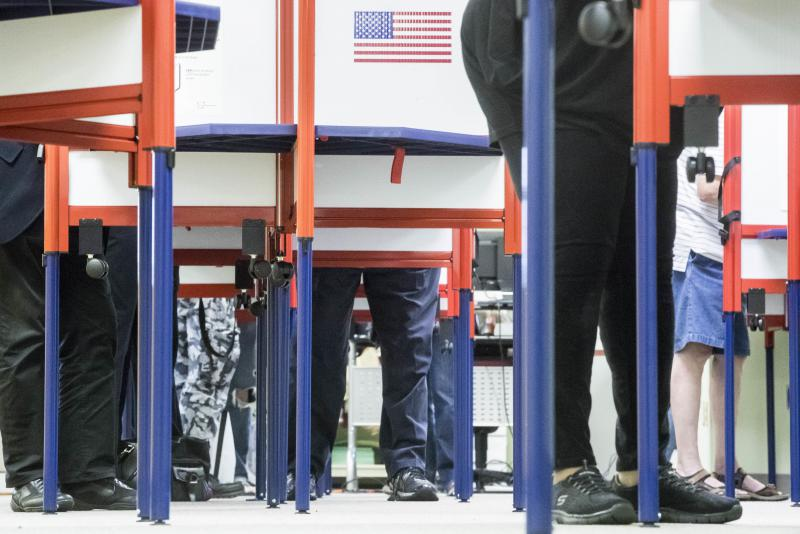 Voters fill out their ballots at the Hamilton County Board of Elections as early voting begins statewide, Wednesday, Oct. 12, 2016, in Cincinnati.