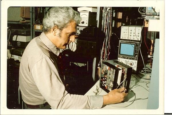 Image of Bob Moog at his work bench.