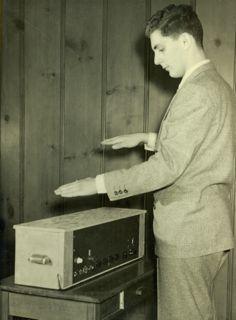 Image of Bob Moog playing the theramin.