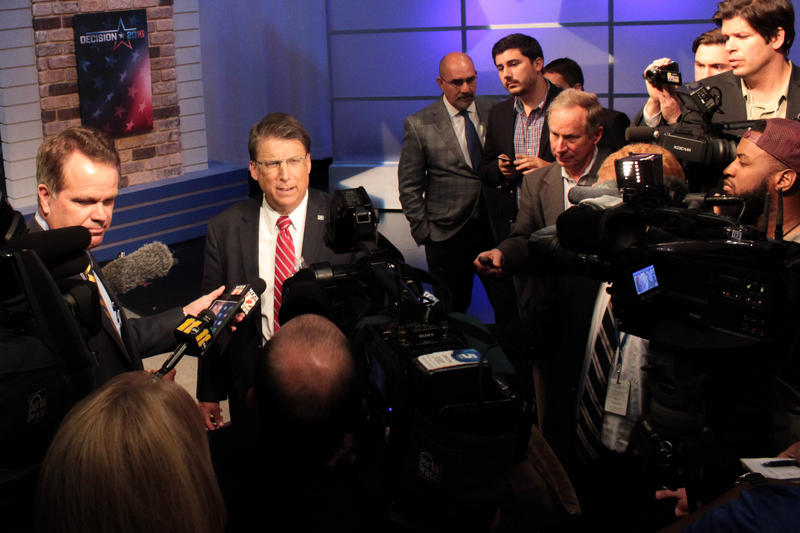 Governor Pat McCrory talks with reporters after the final gubernatorial debate on Tuesday, October 18, 2016.