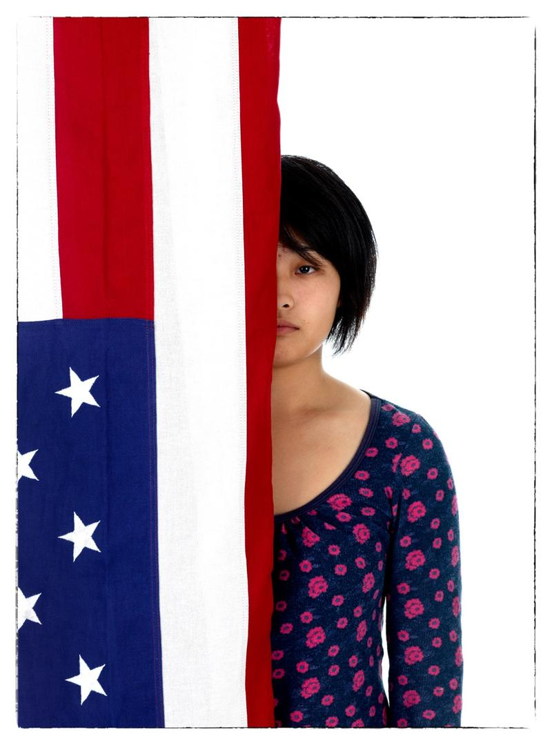 An image from Bright's series 'Young Americans,' a collection of potraits of Generation Y individuals posing with the American flag.