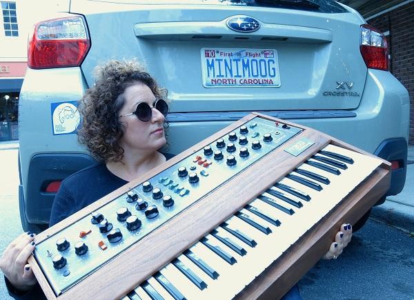 Image of Michelle Moog-Koussa with the minimoog.