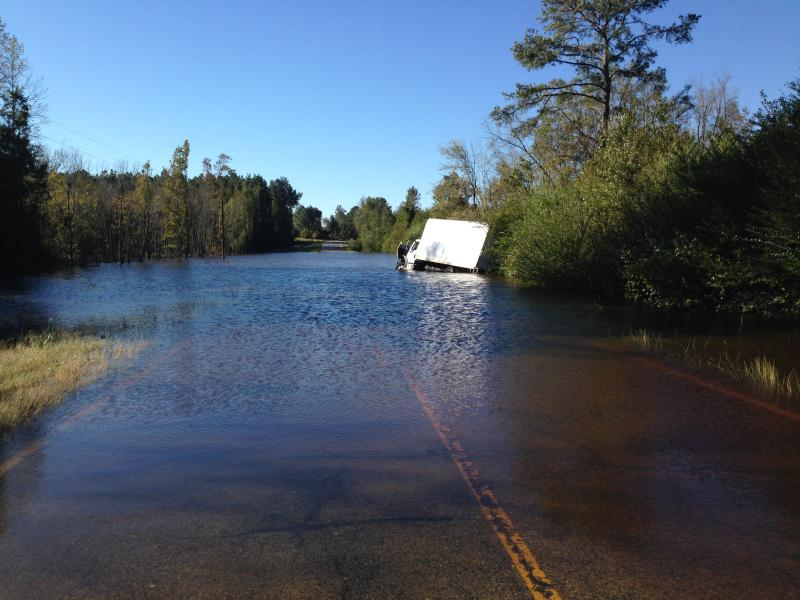 a flooded road after Hurricane Matthew