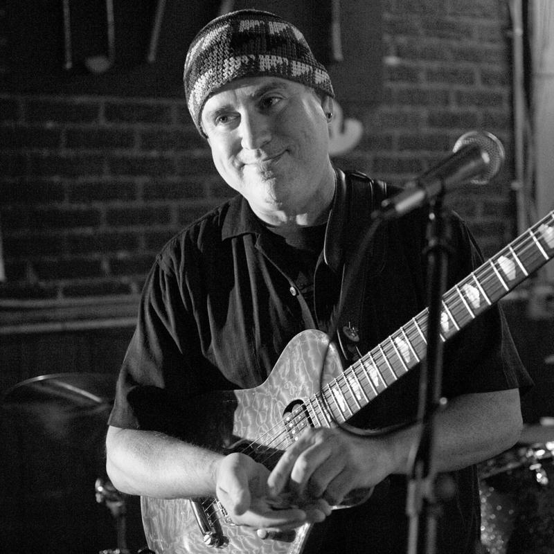 Black and white photo of jazz guitarist Scott Sawyer.