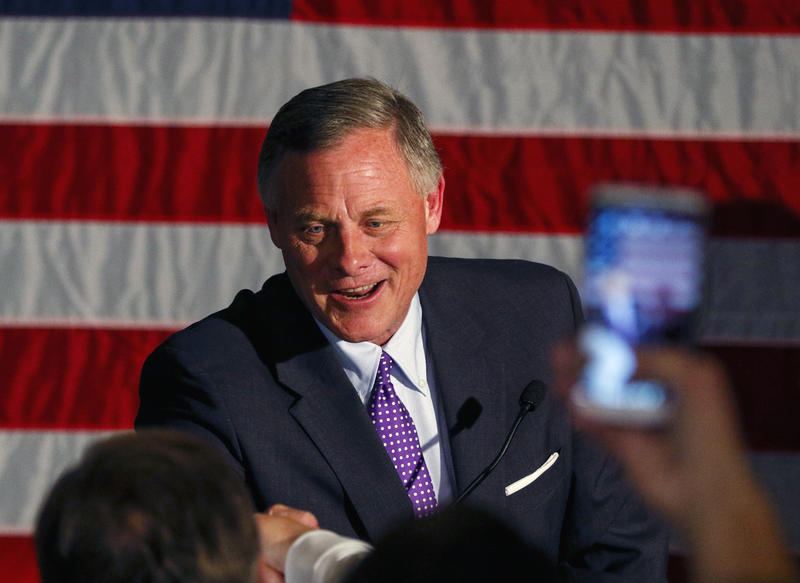 Sen. Richard Burr, R-N.C. greets supporters as he gives his acceptance speech after winning re-election, Tuesday, Nov. 8, 2016, in Winston-Salem, N.C.