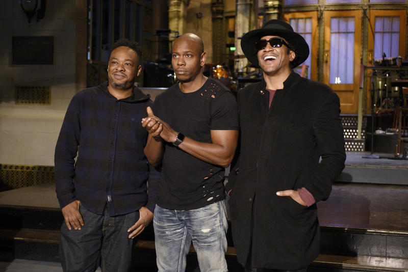 An image of Dave Chappelle with members of A Tribe Called Quest Joribe White and Q-Tip