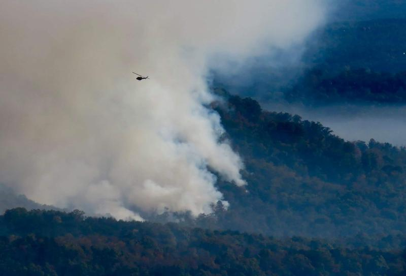 A helicopter circles the Party Rock Fire near Lake Lure
