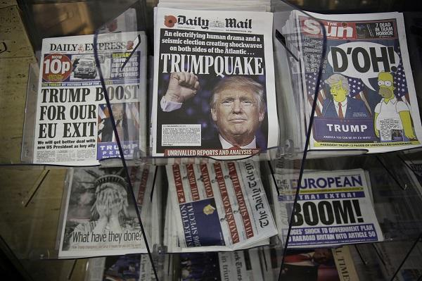 Image of newspaper front pages reporting on Trump's win