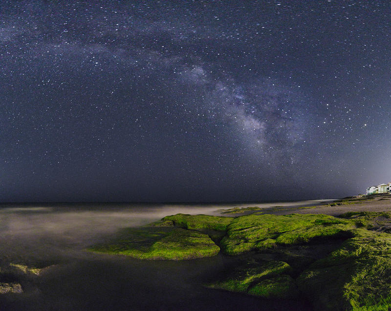 The Milky Way spirals over the coquina outcrop in Kure Beach, NC. This image is made up of two rows, 16 photos stitched together in Photoshop to capture the massive scene on 7/26/2016.