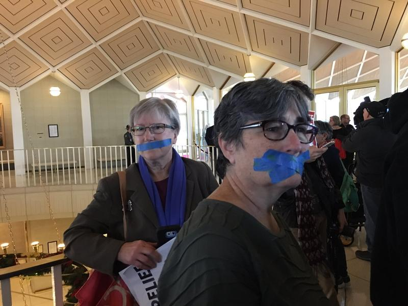 Protesters Jenny Lynch of Apex, left, and Heidi Alcock of Chapel Hill.