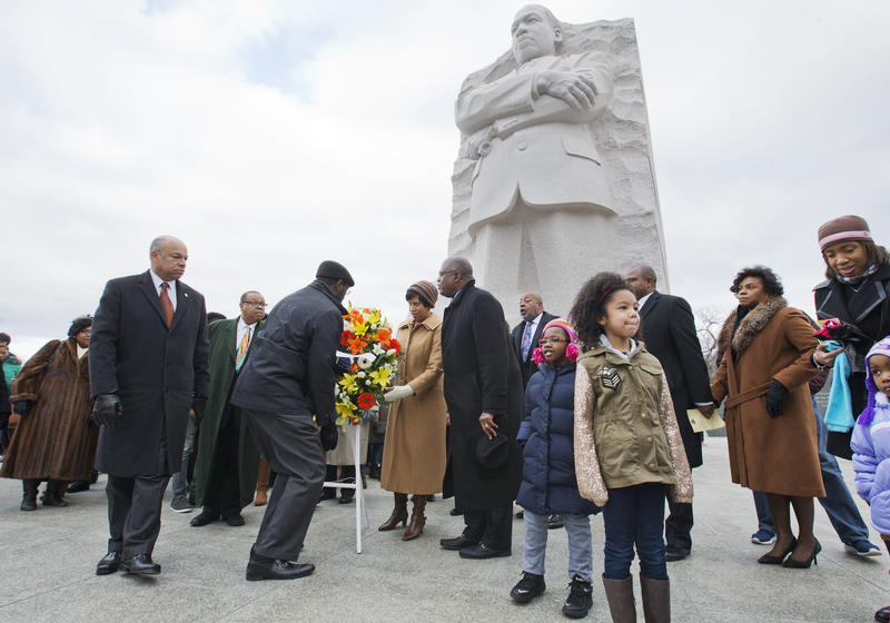 Homeland Security Secretary Jeh Johnson, left, participates in a wreath laying ceremony at the Martin Luther King, Jr. Memorial, on MLK Day, Monday, Jan. 19, 2015, in Washington.