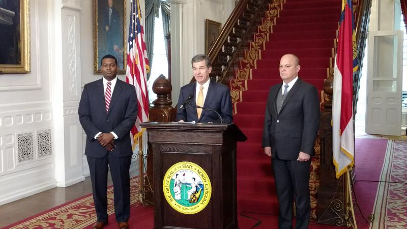 Michael Regan (left) is introduced by Governor Roy Cooper as his nominee to be the next Secretary of the Department of Environmental Quality.