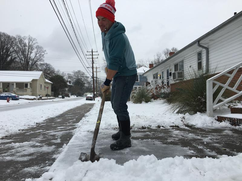 Durham resident Brandon Koch finishes shoveling