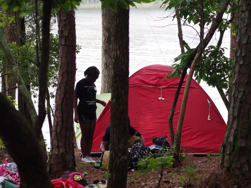 A youth group sets up camp at Jordan Lake State Recreation Area.