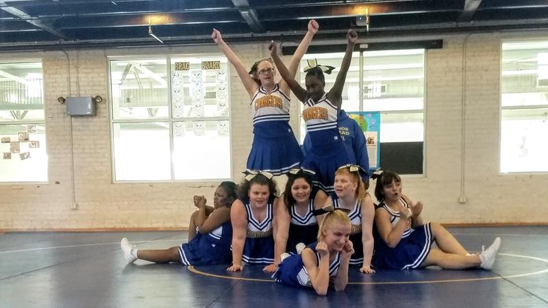 Antoinette Ray (top right) competes at a tournament in January with the Governor Morehead School's cheerleading team. The 17-year-old lost her vision at 13 as a result of glaucoma.