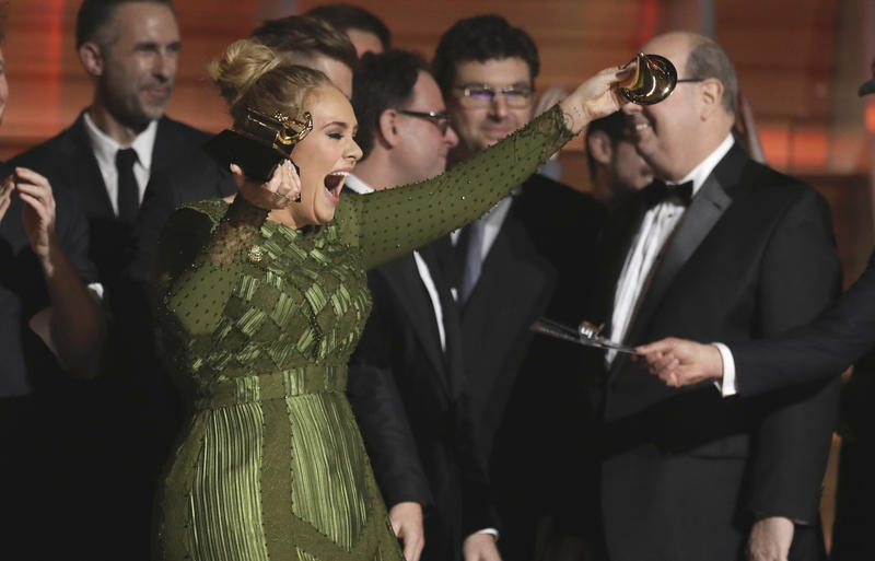 "Adele accepts the award for album of the year for ""25"" at the 59th annual Grammy Awards on Sunday, Feb. 12, 2017, in Los Angeles"