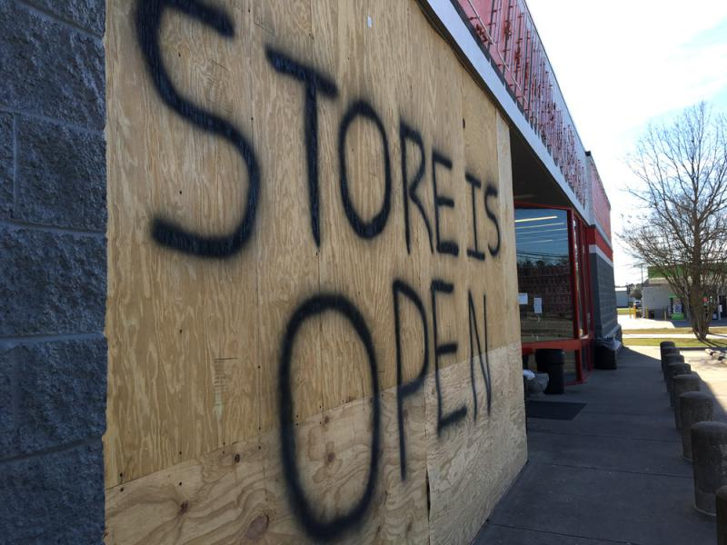 A sign indicates a store is open in flood-damaged Lumberton, N.C.