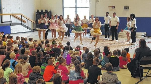 The Bailey Mountain Cloggers perform at an elementary school as part of the Stokes County Arts Council Community Programming.