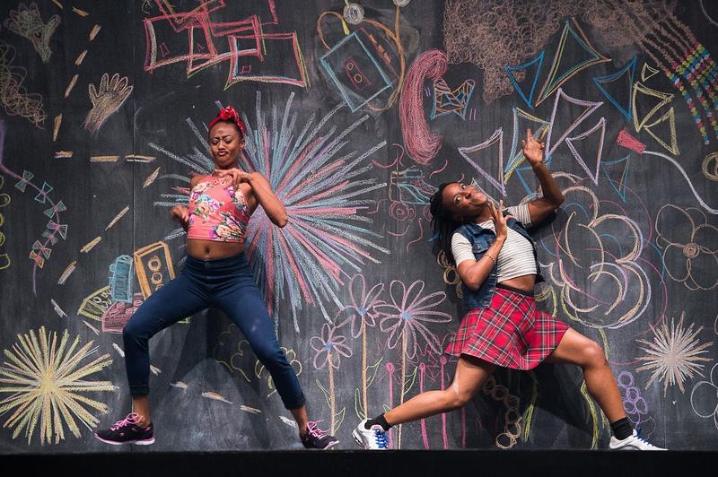 Two dancers Fana Fraser and Beatrice Capote strike a youthful pose in a photo for the dance piece 'Black Girl: Linguistic Play' choreographed by Camille A. Brown.