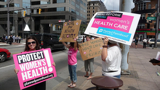 Planned Parenthood volunteers rallying for women's health to be included in health care reform.