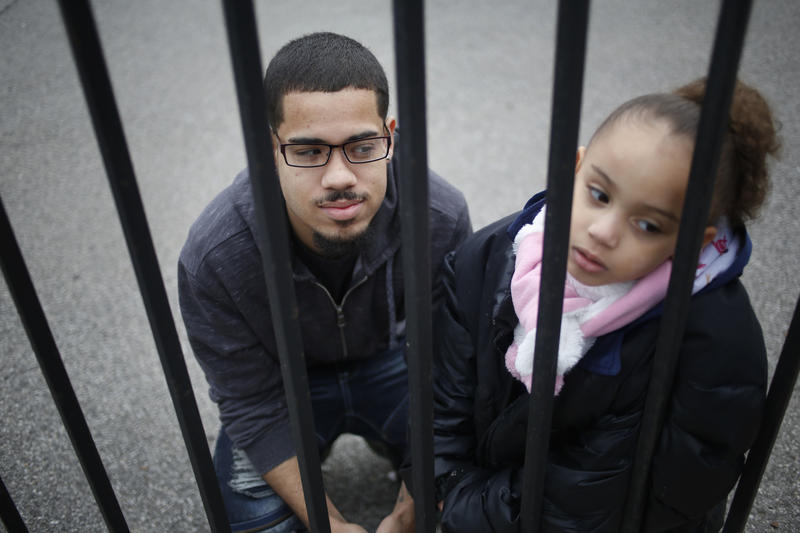 Luis Padilla poses for a picture with his daughter, Isabella near their home in New York. Padilla was arrested at 16 and sent to Rikers Island. New York and North Carolina are the only two states to prosecute all 16 and 17 year olds as adults.