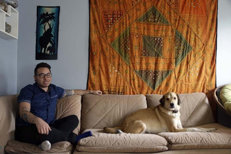 In this photo taken Thursday, May 5, 2016 Joaquin Carcano is shown at his home in Carrboro, N.C. Carcano, a 27-year-old transgender man, works for the University of North Carolina at Chapel Hill. After HB2 passed, he found himself in a difficult position