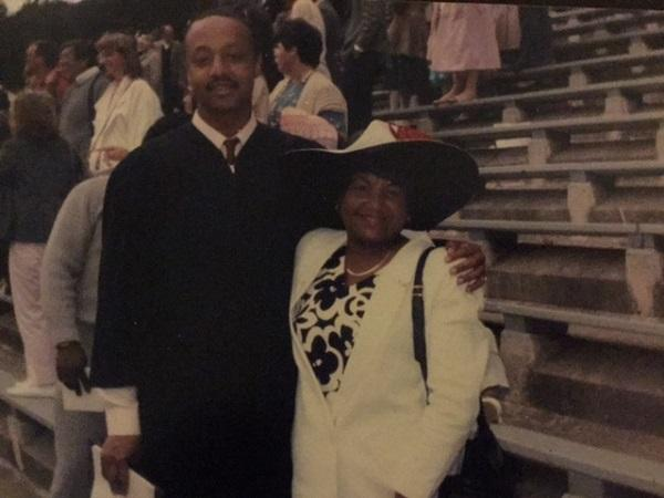 Flores Forbes with his mother at his college graduation in 1986. Forbes completed his degree after serving five years in prison for an attempted murder.
