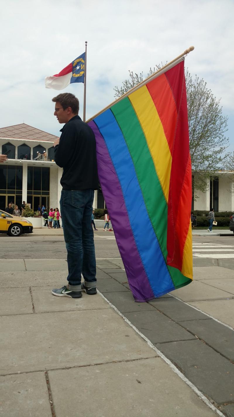 LGBT activist Taylor Schmidt held a pride flag outside the North Carolina Legislature on March 30, 2017.