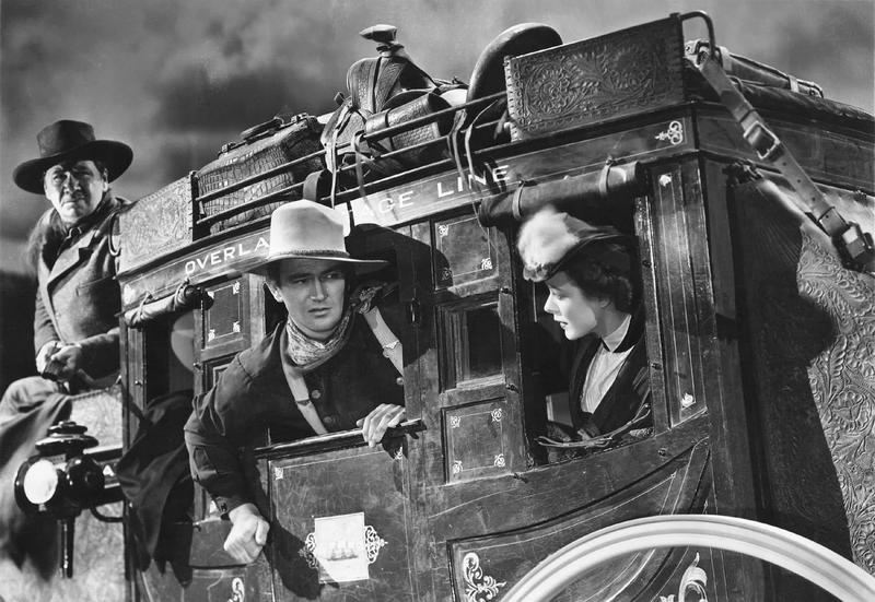 A promotional still with John Wayne and Claire Trevor from the 1939 American Western film 'Stagecoach'.