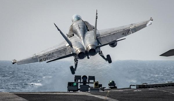"An F/A-18C Hornet assigned to the ""Blue Blasters"" of Strike Fighter Squadron (VFA) 34 takes off from the aircraft carrier USS Carl Vinson."