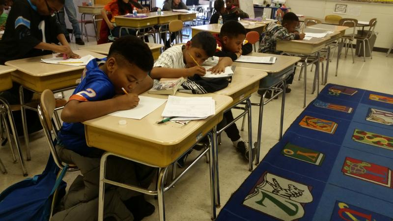 Students at Eno Valley Elementary School in Durham work on homework during a free afterschool program. It's entirely funded by a federal education grant that the Trump administration wants to scrap.
