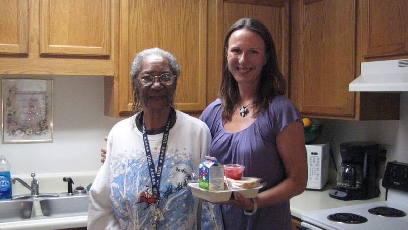 A Meals on Wheels volunteer delivers a meal in Wake County
