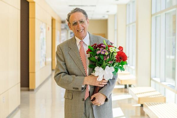 Ron Sederoff holding flowers