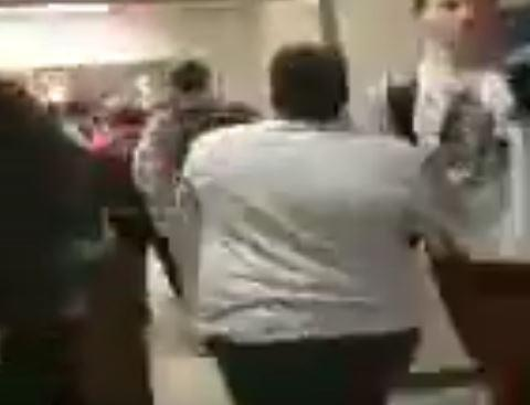 A screenshot from a cell phone video taken at Wake Forest High School shows an altercation between a black and a white student.