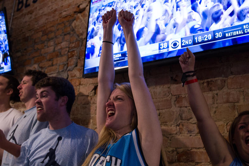 UNC student Kaitlyn Goodson cheers as the North Carolina Tar Heels take the lead against the Gonzaga Bulldogs in the NCAA Championship on April 3, 2017. The Tar Heels would go on to win the game 71 to 65.